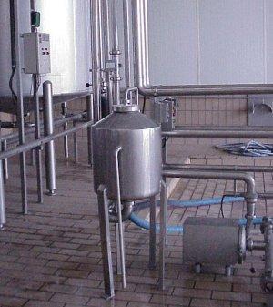 Descargas de leche con desgasificador y contador de turbina